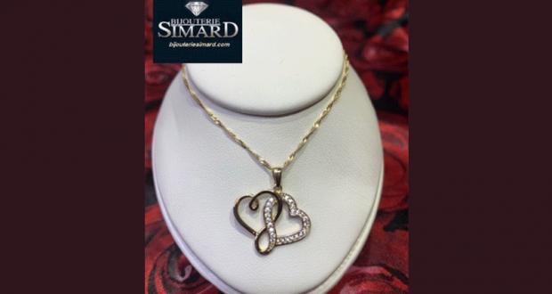Un ensemble chaîne et pendentif en or 10 k